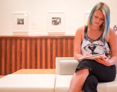 """Sept. 11, 10:55 a.m.: Melissa """"Lyssa"""" Alexandra, a linguistics major, sits in the exhibition space on the second floor of Old Main, awaiting the arrival of a friend."""