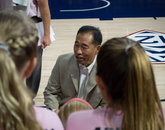 Head coach Dave Rubio gives the team pointers during play. (Photo: Ken Sterns/UANews)