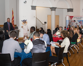 Dean Stuart D. Flynn addresses the new class and others during a luncheon on the first day of school.