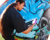 Ingen (Tohono O'odham) adds detail to his art. (Photo: Lexi Obara)