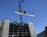 The final steel beam is lifted into place. (Kris Hanning/UAHS BioCommunications)