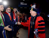 Dr. Robert C. Robbins greets UA graduates. (Photo: James Wood/UANews)