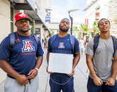 "Arizona football players Jamardre Cobb (left), with sophomore linebacker Jamar Allah, a UA senior, and free safety Dane Cruikshank, a junior. ""We eat together to accomplish the main goal and keep winning,"" Cobb said."