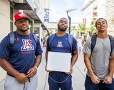 "Arizona football players Jamardre Cobb (left), with sophomore linebacker Jamar Allah, a UA senior, and free safety Dane Cruikshank, a junior. ""We eat together to accomplish the main goal and keep winning,"" Cobb said."