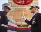 Staff Sgt. Efrain Melecio and Officer Candidate Aaron Clayton ring the USS Arizona bell in the Student Union Memorial Center in remembrance of the eight Arizonans who died on the ship. (Photo: Lilly Berkley/UANews)