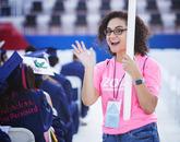 Veronica Cruz-Mercado, UA Bookstores program coordinator,  signals while serving as a volunteer during the Commencement ceremony.