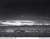 """Moonrise, Hernandez, New Mexico"" by Adams, taken in 1941. The photo is one of Adams' most popular images."
