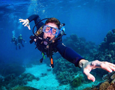 Senior Canyon Smith poses for a photo as he dives the Great Barrier Reef during the Bear Down Under program in Australia.