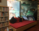The work of David Christiana appears throughout Worlds of Words: a large donor mural, shelf signs and wall wraps including a tractor illustration. Christiana has illustrated more than 20 picture books and currently teaches Illustration at the UA. (Photo: Rebecca Ballenger/UA College of Education)