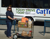 A UA4Food ambassador wheels donations to the Cat Tran.