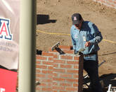 UA mason Eugene Kiley lays bricks. About 25,000 bricks are part of the UA's newest memorial, reflecting the architecture of many campus buildings.