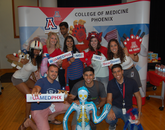 UA College of Medicine – Phoenix students pose at the photo booth during the student fair held during orientation week.