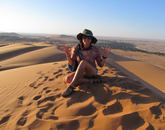Julianna Renzi, who is studying environmental sciences, poses for a photo in one of the world's oldest deserts in Namibia.