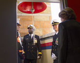 UA President Ann Weaver Hart enters the Student Union Memorial Center tower where a salvaged USS Arizona bell is housed. (Photo: Lilly Berkley/UANews)