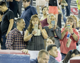 Guests capture the moment from the stands.