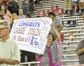A number of guests made signs to honor graduating students.