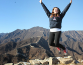 Alumna Julianne Reese, who was in the family studies and human development program, celebrates being at the Great Wall of China.