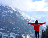 Amanda Horrigan, an alumna who earned a degree in psychology, celebrates after a long hike in the Swiss Alps.