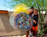 A camper checks out the giant glass kaleidoscope at the Sonoran Glass School.