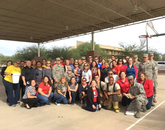 Hundreds of Davis-Monthan Air Force Base service members and firefighters attended a pre-Thanksgiving event. Through UA Cares, the UA Office of Community Relations coordinated a campus drive in support of the event.