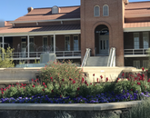 """""""You can show this photo to any Wildcat and they will know that it is the symbol for the University of Arizona. On any given day you can see a graduate, an engagement, a baby or family photos being taken with Old Main as the backdrop. It is more a part of growing up than Dirtbags!!!"""" – Jill Hall, manager of alumni and community engagement, College of Medicine – Tucson"""