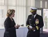 UA President Ann Weaver Hart and U.S. Navy Rear Adm. Stephen C. Evans, commander of the Naval Service Training Command, speak before the dedication ceremony. (Photo: Lilly Berkley/UANews)