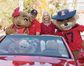 Parade grand marshal Dr. Robert C. Robbins and a guest joined Wilma and Wilbur.