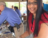 Nilu Dorschner of the Department of Medical Imaging. carves a turkey. More than 50 people at the UA signed up to help cook, donate supplies and serve the meals.