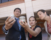 Karletta Chief and Paloma Beamer inspect water samples collected at the San Juan River, which were delivered by Navajo Nation Vice President Jonathon Nez.