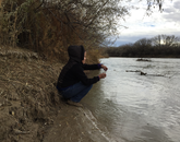Karletta Chief samples San Juan river water.