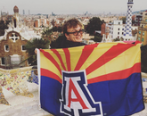 Jackson Chamberlain, a junior studying political science and Spanish, poses with a UA flag in the famous Güell Park of Barcelona, Spain, during the CEA Barcelona program.