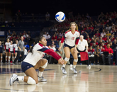 Penina Snuka (left) goes for a dig, preventing the opposing team from taking the point. (Photo courtesy of Arizona Athletics)