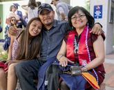 Molly Dayzie, who received a master's degree in clinical systems leadership from the College of Nursing, with her daughter, Daryline, and husband, Jimmie.