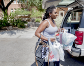 """Altherica """"Nilah"""" Williams, an incoming freshman from Laveen, Arizona, arrives with groceries and her belongings to move into Yavapai Residence Hall at the UA. Williams was assisted by her mom, Barbara Williams, and a family friend, Lamont Turner."""
