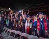 A group of Native American students celebrate their graduation from the UA. (Photo: John de Dios/UANews)