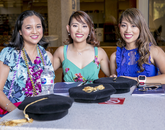 Michelle Stephanie Celeste I and Michelle Stephanie Celeste II, identical twins from Las Vegas, sit with their friend Rizalyn Delgado (left). All three studied online, graduating with doctorates in nursing practice. (Photo: John de Dios/UANews)