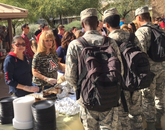 More than 300 airmen and firefighters received an early Thanksgiving luncheon with food donated by the UA and others.