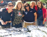 Gloria Andrews (left) of the College of Agriculture and Life Sciences, Cheryl Plummer of the Arizona Student Unions, Licett Hernandez of the Student Affairs Systems Group and also Cindy Shriver and Jackie Cole of Career Services were among the UA employees to volunteer during the event at Davis-Monthan.