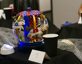 A carved pumpkin decorated as a red and blue carousel.