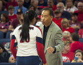 Head coach Dave Rubio gives tips to Penina Snuka. (Photo courtesy of Arizona Athletics)