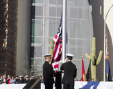 UA Naval Reserve Officers Training Corps members raise the flag to its permanent home. (Photo: Lilly Berkley/UANews)