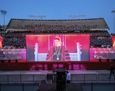Dr. Robert C. Robbins, participating in his first Commencement as UA president, welcomes the crowd to Arizona Stadium. (Photo: John de Dios/UANews)