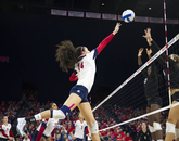 Taylor Arizobal takes to the net in play against Stanford. (Photo courtesy of Arizona Athletics)