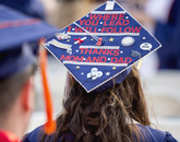 Sarah Rojo, who received a degree in general studies, looks for her family in the stands at Arizona Stadium.