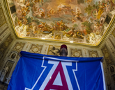 Marc Sanchez, studying Spanish and studio art, displays a UA flag in the Villa Borghese in Rome.