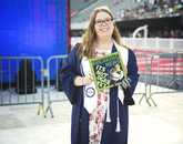 Taylor Brestle, who graduated with a degree in journalism, decorated her cap with an ogre pun.