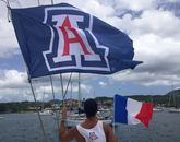 Rachel Franke, who is studying musical theatre, flies the Arizona flag in Les Trois Islets Bay, Martinique.