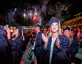 Anabelle Baggs, who graduated with a Bachelor of Science from the College of Agriculture and Life Sciences, enjoys the fireworks. Baggs, who majored environmental sciences, is planning on going to graduate school.