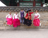 Senior Victoria Le captures international students jumping for joy wearing traditional clothing at Changdeokgung Palace during an exchange at Seoul National University.