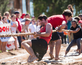 One long-established tradition is that student organizations compete in a tug-of-war battle, in mud.